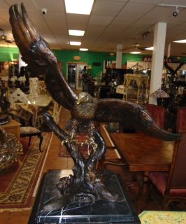 "Bronze Eagle Sculpture on Marble Beautiful and Large Bronze American Bald Eagle Sculpture on a Black Marble Base. Artist Signed. This Sculpture is made entirely from Bronze on a Marble base. Cast and crafted one piece at a time in the traditional lost wax method. High Quality Bronze with excellent Detail and patina. Measures 38"" tall x 36"" wide x 20"" deep. approximately 50 to 60 lbs. Condition is Brand New, Mint. No Damage at all. Several Shipping Options Available. Starting Bid $250. Auction Estimate $1,500 - $2,000."