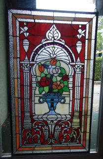 "Custom Tiffany Style Stained Glass Hanging Panel Custom Tiffany Style Stained Glass Hanging Panel. High Quality. Panel measures 34-1/2"" tall x 20-1/2"" wide. Condition is New, Mint. No Damage. Several Shipping Options Available. Starting Bid $80. Auction Estimate $120 - $150."