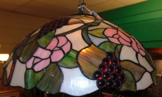 "Tiffany Style Stained Glass Hanging Light Fixture Tiffany Style Domed Stained Glass Hanging Light Fixture with Grapes and Blue Jays. Measures 21"" wide x 11"" tall. Single Light. Condition is very good with minimal wear. No damage. Several Shipping Options Available. Starting Bid $50. Auction Estimate $150 - $200."