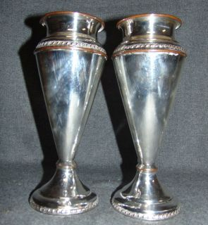 """Vintage Pair (2) of Silvercraft Plated Vases Vintage Pair (2) of Silver Plated Vases by Farber Bros Silvercraft, New York. Each measures 9"""" tall. Condition is good with some wear and scratches typical from age. Rim of one has slight dent. Starting Bid $20 for the pair. Auction Estimate $50 - $60."""