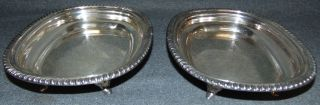 """Pair (2) of Silver Plated Serving Dishes by LBS Co. Pair (2) of Silver Plated Footed Dishes by Lawrence B. Smith Co. Marked """"LBS Co."""" and """"E.P.N.S."""". Each measures 2"""" tall x 9"""" wide x 7-1/2"""" deep. Condition is good with some wear and minor surface scratches typical from age and use. No damage. Starting Bid $30 for the pair. Auction Estimate $40 - $50."""