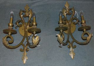 "Pair (2) of Wall Sconces Pair (2) of  Wall Sconces. Each measures 24"" tall x 12"" wide x 8-1/2"" deep. Condition is fair with some crystals missing. Starting Bid $20. Auction Estimate $20 - $40."