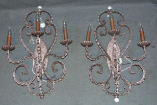 """Pair (2) of Wall Sconces  Pair (2) of Wall Sconces. Each measures 25"""" tall x 17"""" wide x 6-1/2"""" deep. Condition is fair to good with some crystals missing. Several Shipping Options Available. Starting Bid $20. Auction Estimate $50 - $70."""