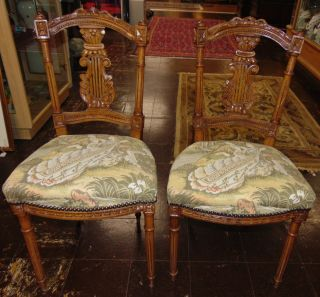 """Pair (2) of Antique Side Chairs Tapestry Sweet Pair (2) of Antique Carved Walnut Side Chairs with Tapestry Upholstered Seats. Each measures 34-1/2"""" tall x 17-1/2"""" wide x 17"""" deep. Condition is good. No damage. Several Shipping Options Available. Starting Bid $120 for both. Auction Estimate $150 - $250."""