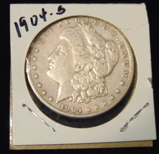 Morgan US Silver Dollar 1904-s Morgan US Silver Dollar. Low Mintage. Dated 1904-s. Circulated. In House, Flat Rate Shipping on this item is $11.50. Insurance included. Starting Bid $50. Auction Estimate $200 - $250.