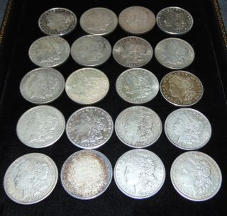 """20 United States Silver """"Peace"""" Dollars 1921 20 United States Silver """"Peace"""" Dollars. Each Dated 1921. Circulated. In House, Flat Rate Shipping on this item is $28.50. Insurance included. Starting Bid $50. Auction Estimate $450 - $500."""