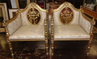 """Pair (2) of Antique Gothic Arm Chairs Pair (2) of Antique Gothic Arm Chairs. Each measures 34"""" tall x 25"""" wide x 24"""" deep. Overall condition is good to fair. Wear consistent with age and use. Some paint losses. Several Shipping Options Available. Starting Bid $250 for Pair. Auction Estimate $450 - $600."""