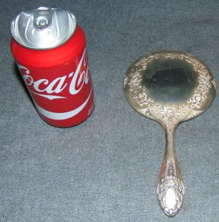 """Vintage Sterling Silver Hand Mirror Vintage Sterling Silver Hand Mirror. Marked Sterling. Measures 8-1/2""""  x 4-1/2"""". Overall condition is good to fair. Wear consistent with age and use. Small dent on side. Several Shipping Options Available. Starting Bid $30. Auction Estimate $40 - $80."""