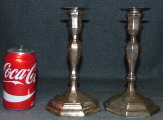 "Pair (2) English Sterling Silver Candlesticks Pair (2) of English Sterling Silver Candlesticks. Each measures 8-1/2"" tall x 4-1/2"" wide. Condition is good not perfect. Several Shipping Options Available. Starting Bid $100 for both. Auction Estimate $125 - $200."