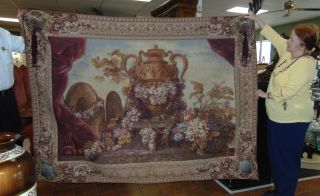 "European Style Wall Tapestry European Style Wall Tapestry. Beautiful European Style Tapestry Wall Hanging with Grapes and Floral Design. Measures 60"" tall x 80"" wide. Condition is very good to excellent. No damage. Several Shipping Options Available. Starting Bid $200. Auction Estimate $400 - $500."