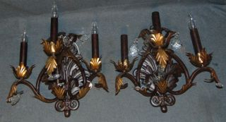 """Pair (2) of 3 Light Wall Sconces Pair (2) of 3 Light Wall Sconces. Each measures 20"""" tall x """"17 wide x 11"""" deep. Condition is fair with some crystals missing. Several Shipping Options Available. Starting Bid $50. Auction Estimate $70 - $100."""