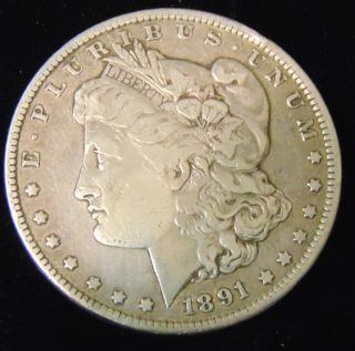 Morgan US Silver Dollar 1891 Morgan US Silver Dollar. Dated 1891. Circulated. In House, Flat Rate Shipping on this item is $11.50. Insurance included. Starting Bid $40. Auction Estimate $50 - $60.
