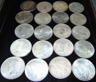 "20 United States Silver ""Peace"" Dollars 1922 20 United States Silver ""Peace"" Dollars. Each Dated 1922. Circulated. In House, Flat Rate Shipping on this item is $28.50. Insurance included. Starting Bid $400. Auction Estimate $450 - $500."