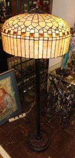 """Tiffany Style Stained Glass Floor Lamp Tiffany Style Stained Glass Floor Lamp. Measures 57"""" tall x 19"""" wide. Condition is Like New. Very good. No Damage. Several Shipping Options Available. Starting Bid $100. Auction Estimate $150 - $250."""