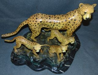 "Bronze Cheetah Family Sculpture Bronze Cheetah Family Sculpture on a Black Marble Base. Large and heavy. Cold Painted Bronze Finish.  Signed ""Allan Barnes"" and dated 2008. Sculpture measures 18"" tall x 24"" wide x 14"" deep. Condition is Brand New, Mint. No Damage at all. This Sculpture is made entirely from Bronze with a Marble Base. Starting Bid $400. Auction Estimate $400 - $750."