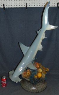 """Bronze Hammerhead Shark on a Reef Sculpture Large Bronze Hammerhead Shark on a Reef with Stingray Sculpture. Cold Painted Bronze Finish. Signed """"Allan Barnes"""" and dated 2005. Sculpture measures 41"""" tall x 20"""" wide. Condition is good. No Damage at all. Some paint losses (see photos). This Sculpture is made entirely from Bronze. Several Shipping Options Available. Starting Bid $150. Auction Estimate $450 - $600."""