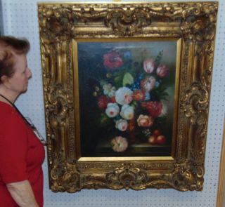 """Floral Still Life Reproduction Oil Painting Beautiful Floral Still Life Reproduction Oil Painting. Frame measures 37-1/2"""" tall x 33"""" wide x 5"""" deep. Condition is good. No Damage. Some crazing in canvas. Several Shipping Options Available. Starting Bid $80. Auction Estimate $100 - $150."""