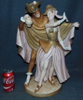 """19th Century Royal Dux Figure Masquerade Couple Large, 19th Century Royal Dux Porcelain Figure of a Masquerade Couple Dancing. Measures 20"""" tall x 14"""" wide. Condition is good. Some Crazing. Bottom is marked. Several Shipping Options Available. Starting Bid $250. Auction Estimate $400 - $500."""