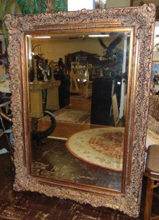"""Large French Style Gold Mirror Large and highly decorative, French Style Gold tone Mirror. Beveled. Very Ornate, traditional frame measures 75"""" x 54"""". May hang either way or Stand alone. Condition is very good. Excellent. No damage. Several Shipping Options Available. Starting Bid $250. Auction Estimate $400 - $600."""
