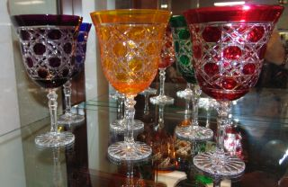 """6 Multi-Color Bohemian Cut Crystal Wine Glasses Beautiful Set of 6 Multi-Color Bohemian Cut to Clear Crystal Wine Glasses. Heavy and high quality European Leaded Crystal. Each measures 7-3/4"""" tall x 4-1/2"""" wide. Condition is New, Mint. No Damage. Includes Fitted and lined Gift Box. Starting Bid $150 for all 6. (Matching Champagne glasses next lot). Auction Estimate $200 - $250."""