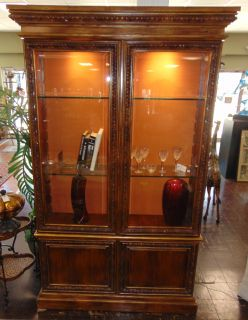 """4 DOOR DISPLAY CABINET Tall 4 Door Display Cabinet. Silk lined Display with glass shelves. Measures 97"""" tall x 57"""" wide x 16"""" deep. Overall condition is good. Starting Bid $10. Auction Estimate $50 - $500."""