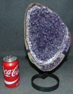 """Large Amethyst Crystal Geode on Iron Stand Beautiful & Large Brazilian Amethyst Crystal Geode on a Wrought Iron Stand. These are spectacular, one-of-a-kind specimens from Brazil. Measures 13"""" tall x 7-1/2"""" wide. Condition is very good. New condition. No Damage. Several Shipping Options Available. Starting Bid $50. Auction Estimate $200 - $300."""