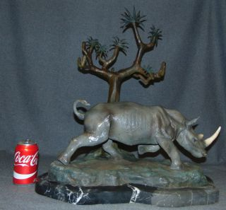 """Bronze Rhinoceros on Marble Sculpture Bronze Rhinoceros Sculpture on a thick, Black Marble Base. Cold Painted Bronze Finish. Artist signed. Measures 24"""" tall x 21"""" wide x 15"""" deep. This Sculpture is made entirely from Bronze with a Marble Base. Condition is Brand New, Mint. No Damage at all. Several Shipping Options Available. Starting Bid $250. Auction Estimate $600 - $800."""