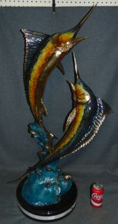 """Bronze Double Sailfish Sculpture on Marble Awesome Bronze Double Sailfish Sculpture on a thick, Triple Marble Base. Heavy Sculpture. Artist signed and numbered 23 of 50. High Quality Bronze with excellent Detail. Cold Painted Bronze Finish. Cast and crafted one piece at a time in the traditional lost wax method. Bronze may be used indoor or outdoor. Measures 41"""" tall x 24"""" wide. Condition is Brand New, Mint. No Damage at all. Several Shipping Options Available. Starting Bid $500. Auction Estimate $1,000 - $1,250."""