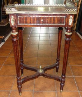 """Antique Inlaid Side Table Antique Inlaid 1 Drawer Side Table with Gallery. Measures 28"""" tall x 20"""" wide x 12-1/2"""" deep. Overall condition is good to fair. Wear consistent with age and use. Several Shipping Options Available. Starting Bid $50. Auction Estimate $150 - $250."""