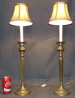 """Pair (2) of Brass Candle Table Lamps Pair (2) of Brass Candle Table Lamps. Each measures 26"""" tall to top of shade. Overall condition is good to fair. Wear consistent with age and use. Several Shipping Options Available. Starting Bid $20. Auction Estimate $50 - $80."""