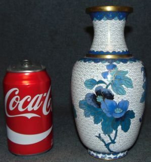 "Vintage Cloisonne Vase Vintage Cloisonne Vase. Measures 8"" tall. Condition is very good. Excellent. No damage. Several Shipping Options Available. Starting Bid $50. Auction Estimate $150 - $200."