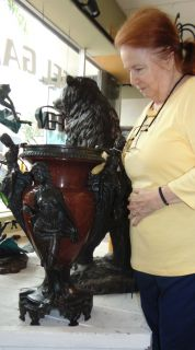 """Large Rouge Marble & Bronze Figural Urn  Large Rouge Marble & Bronze Figural Urn. Very Heavy. Measures 29-1/2"""" tall x 23"""" wide x 21"""" deep. Condition is Like New. Very good. No Damage. Starting Bid $250. Auction Estimate $250 - $1,000."""