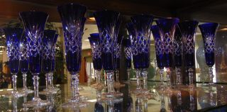 """12 Cobalt Blue Bohemian Cut Crystal Champagne Glasses Set of 12 Cobalt Blue Bohemian Cut Crystal Champagne Glasses. Heavy and high quality European Leaded Crystal. Each measures 9"""" tall. Condition is New, Mint. No Damage. Includes Fitted and lined Gift Boxes. Several Shipping Options Available. Starting Bid $250 for all 12. Auction Estimate $350 - $500."""