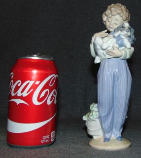 "LLadro Porcelain Figure #7609 My Buddy LLadro Porcelain Figure #7609 My Buddy. Measures 8-1/4"" tall. Collectors Society Edition 1989. Bottom is marked. Condition is very good. Excellent. No damage. Several Shipping Options Available. Starting Bid $30. Auction Estimate $50 - $80."