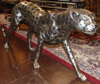 """Large Silvered Bronze Cheetah Sculpture Large Silvered Bronze Cheetah Sculpture. High Quality Bronze with excellent Detail and patina. Cast and crafted one piece at a time in the traditional lost wax method. Bronze may be used indoor or outdoor. Measures 22"""" tall x 58"""" wide x 8"""" deep. Condition is Like New. Very good. No Damage. Several Shipping Options Available. Starting Bid $500. Auction Estimate $800 - $1,000."""