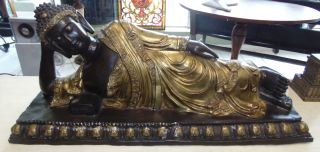 """Large Bronze Reclining Buddha Sculpture Large Bronze Reclining Buddha Sculpture. High Quality Bronze with excellent Detail and patina. Cast and crafted one piece at a time in the traditional lost wax method. Bronze may be used indoor or outdoor. Measures 16-1/2"""" tall x 39"""" wide x 14"""" deep. Condition is Excellent. No Damage at all. Several Shipping Options Available. Starting Bid $500. Auction Estimate $800 - $1,000."""