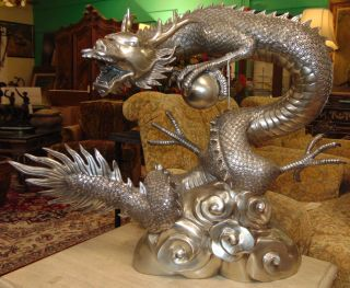 """Silvered Bronze Dragon & Sphere Fountain Sculpture Large and Awesome, Asian Style Dragon & Sphere or """"Pearl"""", Bronze Fountain Sculpture with """"Silvered"""" Patina. High Quality Bronze with excellent Detail and patina. Cast and crafted one piece at a time in the traditional lost wax method. Bronze may be used indoor or outdoor. Sculpture functions as a fountain feature as well and is pre-Fitted to accept Water Pump for Fountain Feature. Weighs aprox 50lbs. Stands 34"""" wide x 27"""" tall x 10"""" deep. This Sculpture is made entirely from Bronze. Several Shipping Options Available. Starting Bid $500. Auction Estimate $1,250 - $1,500."""
