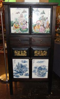 """4 Door Chinese Cabinet Hand Painted 4 Door, 2 Drawer Chinese Cabinet. Measures 55"""" tall x 28"""" wide x 18"""" deep. Condition is very good. Excellent. No damage. Several Shipping Options Available. Starting Bid $150. Auction Estimate $250 - $300."""