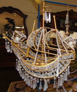 "Sailing Ship Shaped Chandelier  Vintage Brass & Crystal Sailing Ship Shaped Chandelier. Light fixture measures 20"" tall x 24"" wide x 9"" deep. Overall condition is good. Several Shipping Options Available. Starting Bid $80. Auction Estimate $120 - $150."
