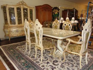 """Antique Italian Painted Dining Suite Magnificent Antique Italian Dining Suite. Hand Painted. Includes Carved Dining Table with 6 chairs and Large Breakfront. Dining Table measures 31-1/2"""" tall x 81-1/2"""" wide x 42"""" deep. Includes Glass top. Breakfront measures 88"""" tall x 81"""" wide x 21"""" deep. Includes 2 Arm Chairs and 4 Side Chairs each 48"""" tall. Overall condition of set is good. Wear consistent with age and use. Some paint losses. No Damage. Several Shipping Options Available. Starting Bid $1,000. Auction Estimate $1,250 - $1,500."""