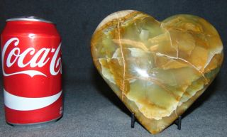 """Heart shaped Green Calcite on an Iron Stand Rare, Heart shaped Green Calcite on an Iron Stand. Measures 6-1/4"""" tall x 6-1/2"""" wide. Condition is Like New. Very good. No Damage. Several Shipping Options Available. Starting Bid $70. Auction Estimate $80 - $100."""