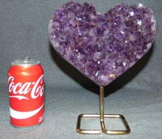 "Heart shaped Amethyst Geode on a Stand Heart shaped Amethyst Geode on an Iron Stand. Geode Measures 6-1/4"" tall x 8"" wide. Total height on stand is 9-1/2"". Condition is Like New. Very good. No Damage. Several Shipping Options Available. Starting Bid $200. Auction Estimate $250 - $350."
