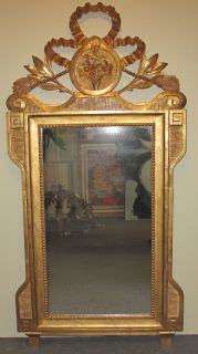 "Gold Tone Carved Wood Mirror Gold Tone Carved Wood Mirror. Measures 58"" tall x 28"" wide. Condition is good. No damage. Several Shipping Options Available. Starting Bid $100. Auction Estimate $150 - $200."