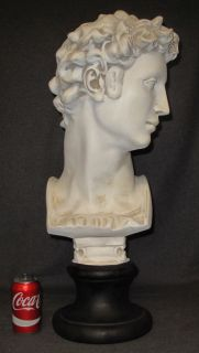 """Ceramic Bust of David  Large Ceramic Bust of David. Measures 28"""" tall x 12"""" wide x 12"""" deep. Overall condition is good. No damage. Several Shipping Options Available. Starting Bid $70. Auction Estimate $100 - $150."""