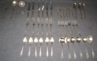 "Sterling Silver Flatware Set Sterling Silver Flatware Set. Aprox 50 oz. of Silver. 42 Pieces total. Includes 6 Forks, 6 Salad Forks, 6 Spoons, 6 Soup Spoons, 6 Knives, 6 Butter Knives & 6 Serving Pieces. Condition is good. No damage. No Display Box. Monogrammed ""M"". Starting Bid $800. Auction Estimate $800 - $1,300."