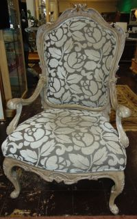 "Upholstered Arm Chair Upholstered Arm Chair. Measures 48"" tall x 29-1/2"" wide x 23"" deep. Overall condition is good to excellent. No damage. Does have some staining. Several Shipping Options Available. Starting Bid $250. Auction Estimate $400 - $500."