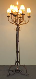 """Vintage Iron Candleabra Floor lamp Vintage Wrought Iron, 9 Light Candleabra Floor lamp. Measures 67"""" tall x 20"""" wide. Condition is good. No damage. One shade missing. Several Shipping Options Available. Starting Bid $50. Auction Estimate $50 - $150."""