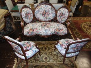 """Victorian Sofa 2 Arm Chairs Ralph Lauren Fabric Beautiful 19th century Victorian Carved Walnut Sofa and 2 Arm Chairs with new Ralph Lauren Fabric. Floral Design. Sofa measures 47"""" tall x 69"""" wide x 34"""" deep. Chairs each measure 39"""" tall x 24"""" wide x 24"""" deep. Condition is very good with minimal wear. No damage. Several Shipping Options Available. Starting Bid $100. Auction Estimate $150 - $250."""