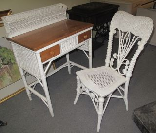 """Antique Wicker Desk & Chair Antique Wicker Desk & Chair. Desk measures 37"""" tall x 28"""" wide x 17-1/2"""" deep. Overall condition is good. Wear consistent with age and use. Starting Bid $30. Auction Estimate $30 - $60."""