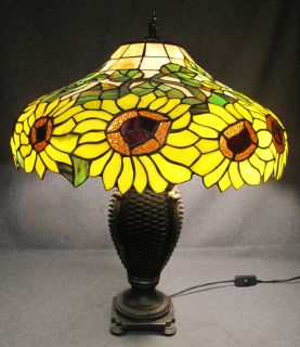 """Stained Glass Table Lamp with Sunflowers Stained Glass Table Lamp with Sunflowers. Measures 25"""" tall x 22"""" wide. Overall condition is Excellent. No damage. Starting Bid $90. Auction Estimate $90 - $200."""
